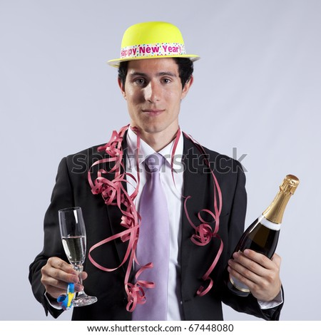 businessman celebrating the new year eve with champagne (isolated on black) - stock photo