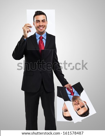 Businessman changing his face - stock photo