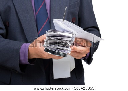 Businessman check a lot of bills in hand - stock photo