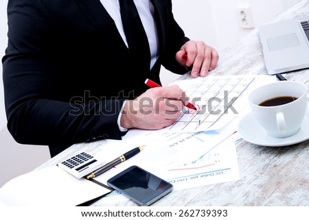 Businessman checking appointments in the calendar at the office
