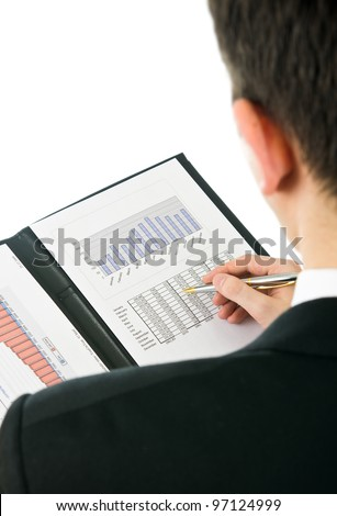 Businessman checking financial results from previous year. - stock photo