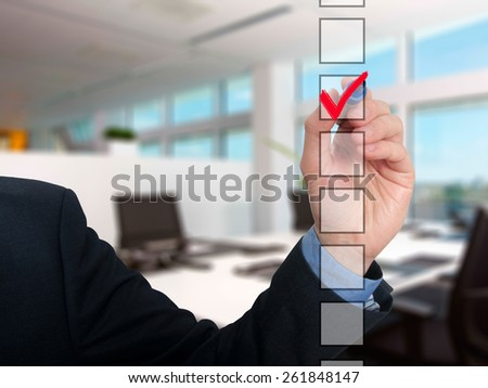 Businessman checking mark checklist marker Isolated on office background. Stock Photo - stock photo