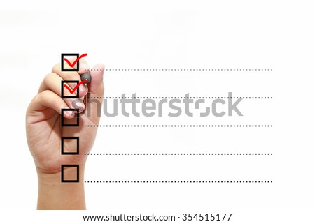 Businessman checking mark on checklist with marker over white - stock photo