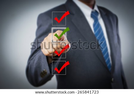 businessman checking on checklist boxes - stock photo