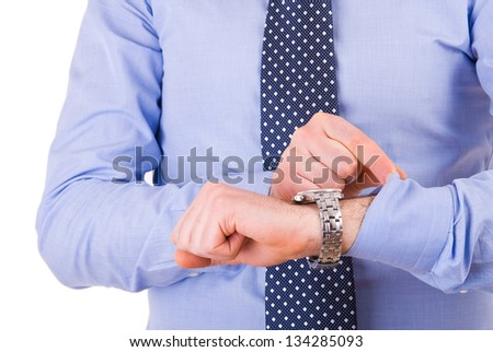 Businessman checking time on his wristwatch. - stock photo
