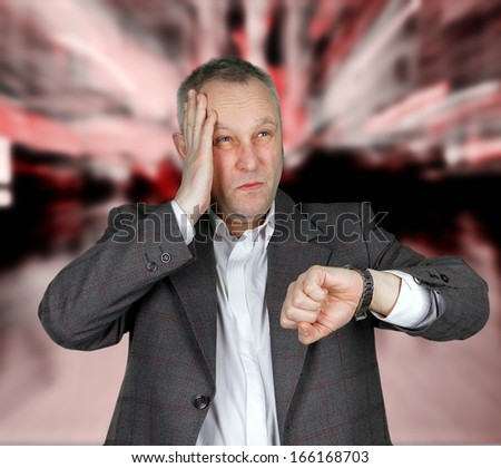 Businessman checking watch in airport - stock photo