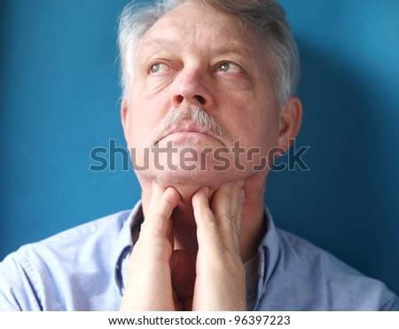 businessman checks for swelling in the lymph glands in his neck - stock photo