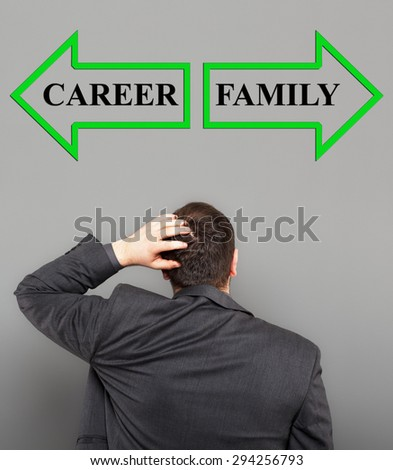 Businessman choose between family and career - stock photo
