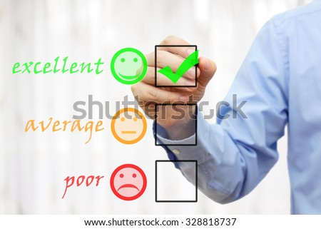 Businessman choosing excellent option  in a survey form - stock photo