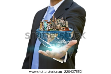 Businessman choosing his holidays with half planet earth in his hands - stock photo