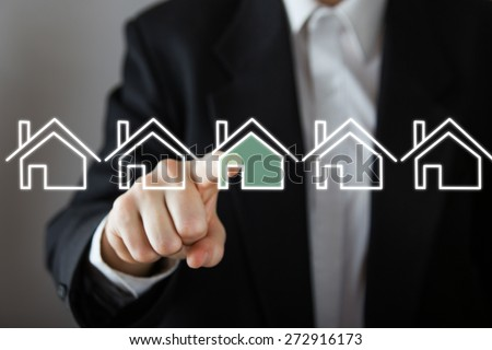 Businessman choosing house, real estate concept. Hand pressing the house icon. Copy space - stock photo