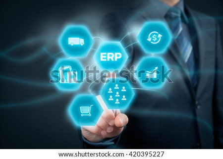 Businessman click on ERP business management software button for collect, store, manage and interpret business data like customers, HR, production, logistics, financials and marketing.  - stock photo