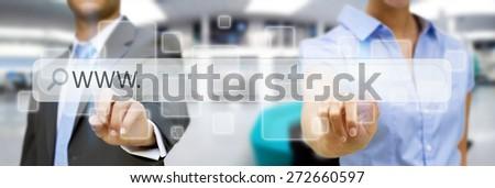 Businessman clicking on tactile interface web address bar - stock photo