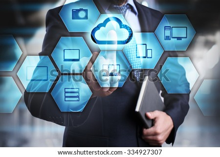 Businessman clicks on the icon with the cloud. cloud technology concept. internet concept.  - stock photo