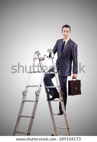 Businessman climbing career ladder against gradient  - stock photo