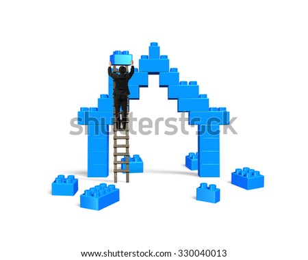 Businessman climbing ladder and holding a blue block to complete house shape of stack blocks, isolated on white background. - stock photo