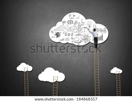 Businessman climbing ladder drawing idea on cloud - stock photo
