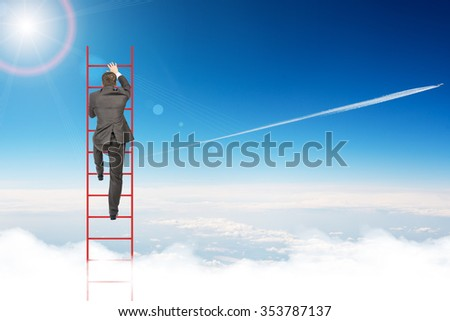 Businessman climbing ladder on blue sky background, rear view - stock photo