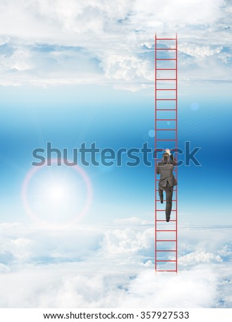 Businessman climbing up ladder - stock photo