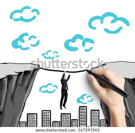 businessman climbs from one mountain to another tightrope - stock photo