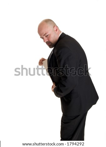 businessman concealing a secret document in his jacket pocket. - stock photo