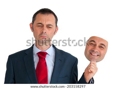 businessman concealing depression with a happy mask  - stock photo