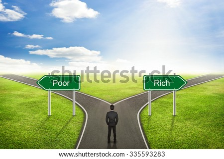 Businessman concept, Poor or Rich road to the correct way. - stock photo