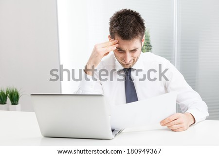 Businessman confused and Scratching Head, with Laptop  - stock photo