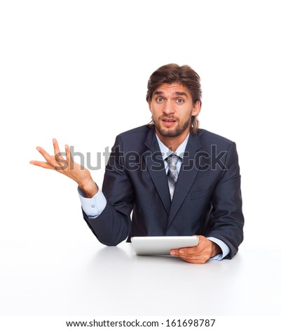 businessman confused unsure expression, unexpected hand gesture of no ideas, hold tablet pad computer, businessman sitting at the desk isolated over white background - stock photo