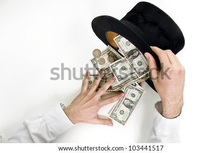 Businessman conjure a lot of  dollars from an old black hat isolated on white background - stock photo
