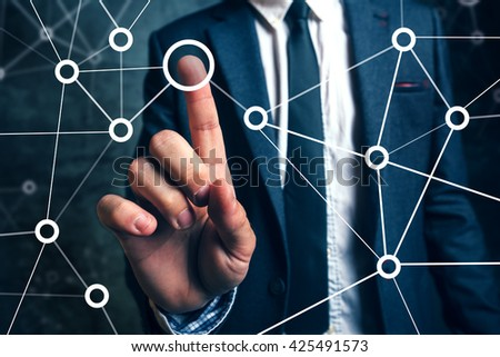 Businessman connecting the dots in business project management, social networking or teamwork organization. - stock photo