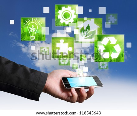 Businessman connection touch screen mobile phone green concept on blue sky - stock photo