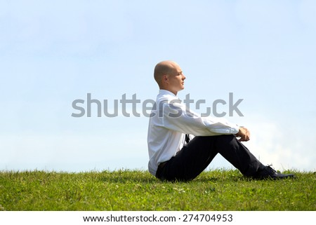 Businessman contemplating in park - stock photo