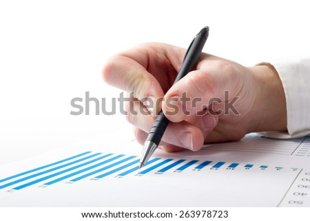 Businessman counting losses and profit working with statistics, analyzing financial  the results - stock photo