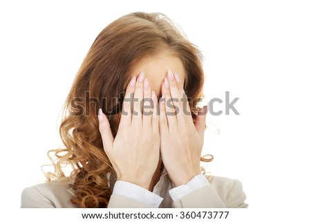 Businessman covering face by hand. - stock photo