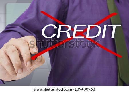 Businessman cross out on Credit word - stock photo