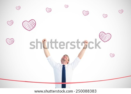 Businessman crossing the finish line against white background with vignette - stock photo