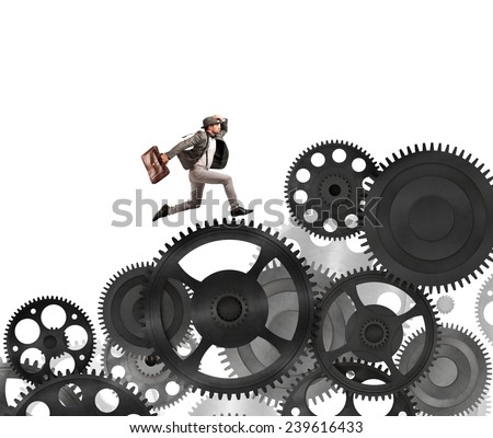 Businessman difficult career in a mechanism system - stock photo
