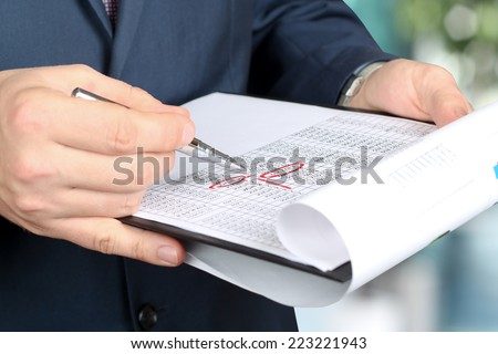 businessman  doing business, standing in the office, analyzing  data in  documents - stock photo
