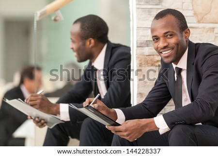 Businessman doing paper work - stock photo