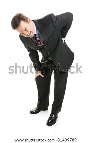 Businessman doubled over in pain.  He's thrown his back out.  Full body isolated. - stock photo
