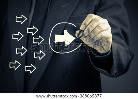 Businessman draw an white arrow as trend leader or leadership concept on screen - stock photo