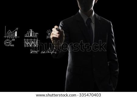 Businessman Draw Grape on Transparent Screen - stock photo