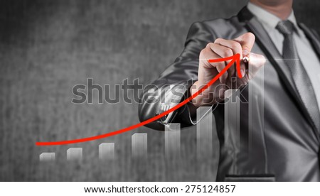 Businessman draw red curve with bar chart, business strategy concept - stock photo