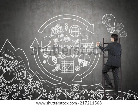 Businessman drawing a concept of business cycle.  - stock photo