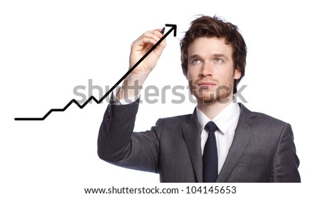 Businessman drawing a graph with black marker - stock photo
