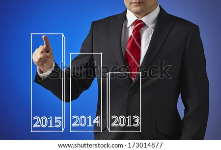 Businessman drawing a growth graph with years 2013, 2014, 2015 - stock photo