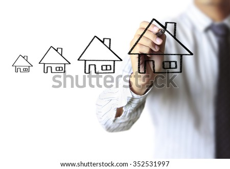 Businessman drawing a house  - stock photo