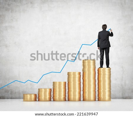 Businessman drawing a monetary line graph.  - stock photo