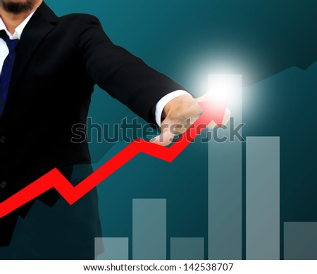 Businessman drawing a rising arrow . business growth Concept. - stock photo